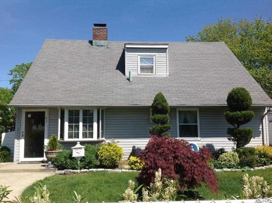 Island Trees SD!! Lovely Updated & Expanded 4 Bedroom, 2 Bath Cape with Detached Garage and 70 x 100 Property. This Inviting home features an Updated Eat In Kitchen, Formal Diningroom, Expanded Family Room, Master Bedroom, Addition Bedroom & Upd. Full Bath on the 1st Floor. Two Additional Bedrooms and Full Bath on 2nd Floor. Newer Siding and Roof, Detached 1.5 Car Garage, Rear Patio all make this a wonderful and comfortable home to own and enjoy.