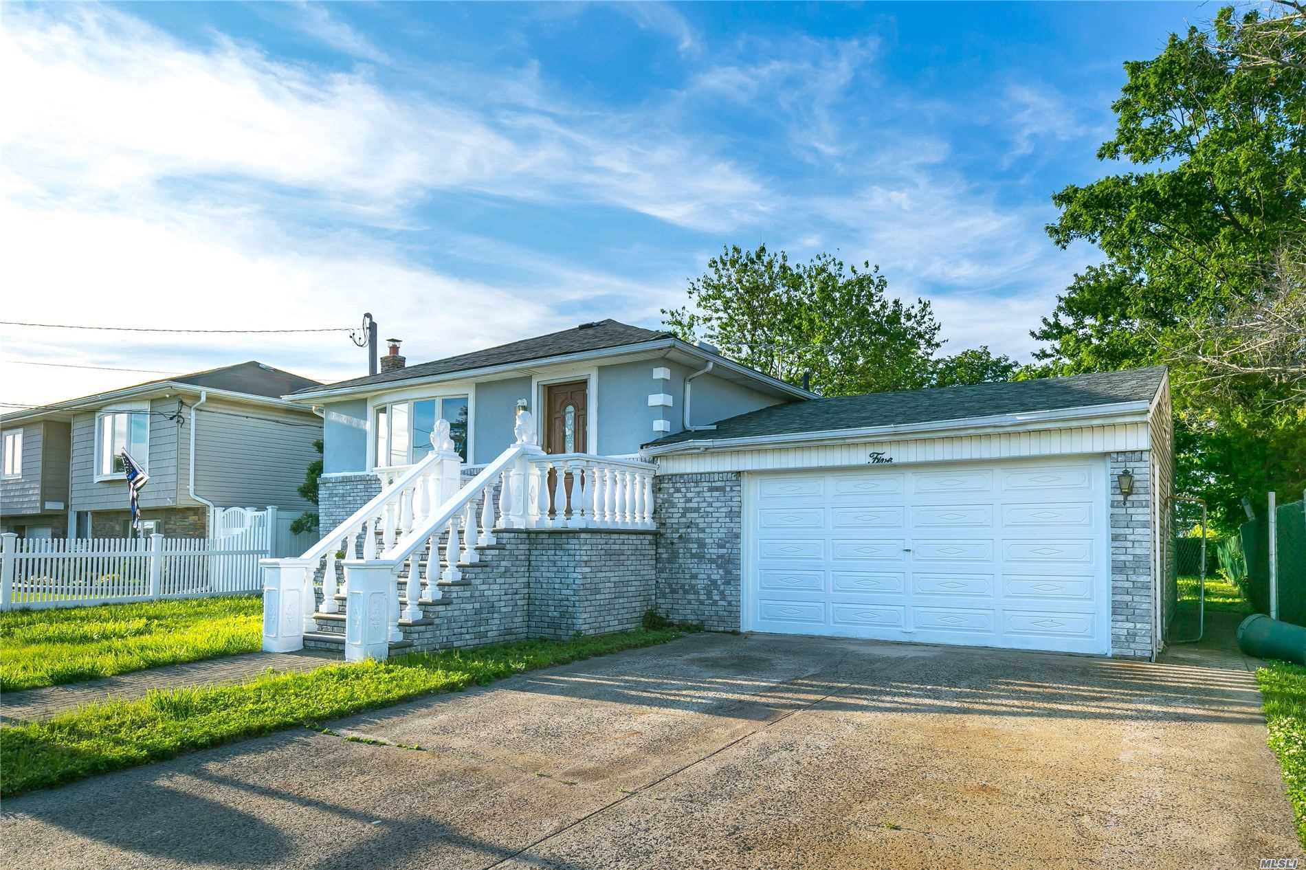 Beautiful raised ranch completely updated new kitchen with high end cabinets with stainless Steel appliances hardwood floors throughout. Full finished basement with a huge back yard.