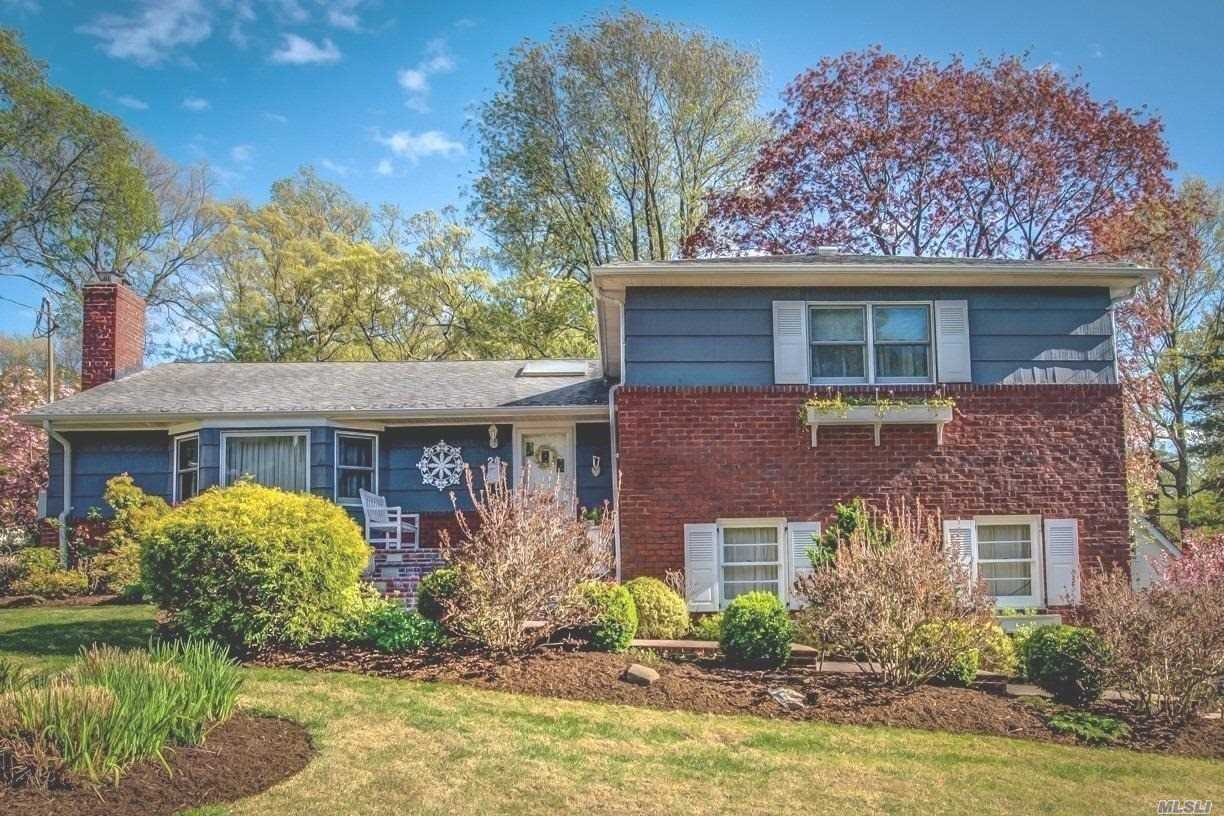 Live the DREAM in this Magnificent Classic Tri-Level Home. Minutes away from LIRR, 39mins to NYC. Warm & Inviting Hardwood floors on the 1st level, Lg Formal Lrm w/fireplace, FDr w/double sliding doors opens up to an expansive outdoor patio for entertaining. EIK with Quaint breakfast nook with breathtaking view of the grounds,  Lower Level includes Lg bright Den with Atrium windows, 1/2Bthrm, plus a Lg Entertainment area with wet bar can be easily converted to a home theater.Low Taxes Must See!