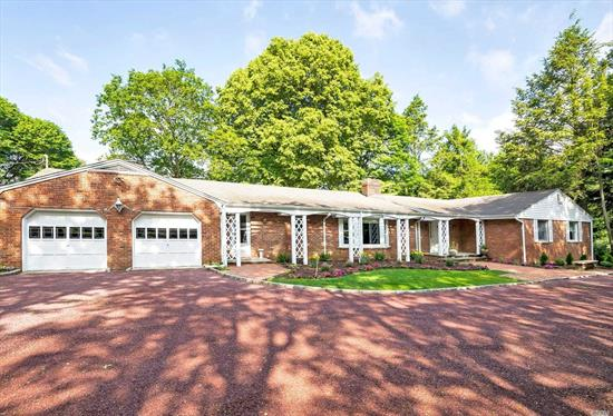 Majestic And Mature Park Like Property Just shy of 4 Acres Custom Built Mid Century Modern Sprawling Brick Ranch With Over Sized Rooms All with Views of Property Automatic Whole House Generator Perfectly Located In The Prestigious North Shore Schools