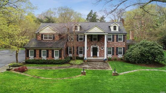 Room For Everyone At This 5400 Square Feet 6 Bedroom Colonial In The Award Winning Locust Valley School District! Wonderful First Floor Entertaining Space Includes Fabulous 30' x 15' Custom Kitchen And 31'x16' Great Room With Bar & Stone FP, Luxurious master Suite. Finished Basement With Gym, Playrooms, And Shop/ Work Area. Numerous Custom Details.