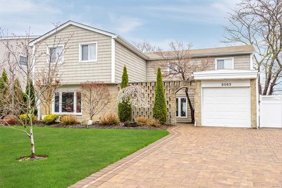 East Bay Mid-Block Colonial--New Beaming Brazilian Floors, Moldings, Woodburning Stone Fireplace, PVC Fence, New Siding, Replaced Windows, Hihats, Pavers--Drive/One Side & Rear Paver Patio & New Central Air Compressor! Backyard is Oversized! Beautiful Front Entry Porch Is An Extra! Come See!