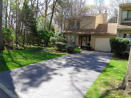 This is desirable end unit is set on a private wooded landscaped property with in ground sprinklers and private driveway. Home features 2 1/2 baths/ LR/DR combo with FP and sliding glass doors leading to patio/ laundry area and inside access to garage. Second floor features Master BR w/Master Ba. Second BR/ Full Bath.