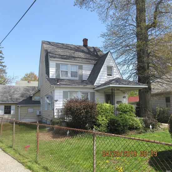 Immaculate sunny and bright legal 2 family house. Price just reduced. Motivated seller. Gigantic main floor, open concept. Featuring lvr, formal dining room, full bath eatin kitchen, queen size bedroom with loft, laundry room common for both apartments. 2 level consists of eatin kitchen, lvr, 2 bedrooms with a third level loft Backyard, garage, driveway, porch,  close to LIRR, great shopping, highways, worship, This a great investment house with tenants already there, or bring mom and dad