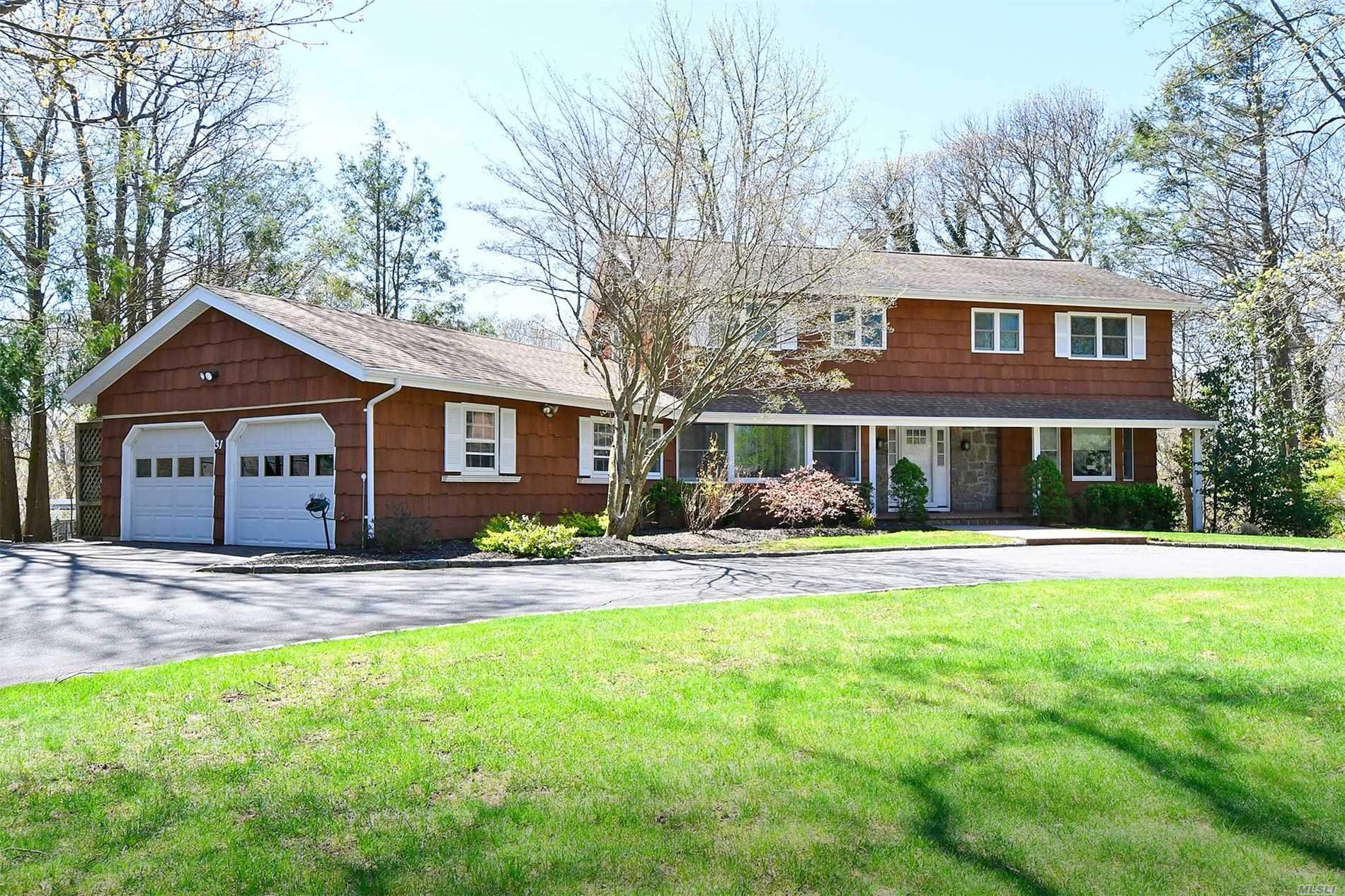 Beautiful expanded Point of Woods Colonial on oversize flat property.This warm & inviting home boasts rich wood floors that guide you through the gracious open layout. Entertaining is easy in the expanded banquet sized dining room. Pristine, well maintained home offers updated windows & AC, Nest systems, elegant moldings & newly refinished garage.Enjoy lush, flat oversized property from the gorgeous composite deck.Half Hollow Hills West.