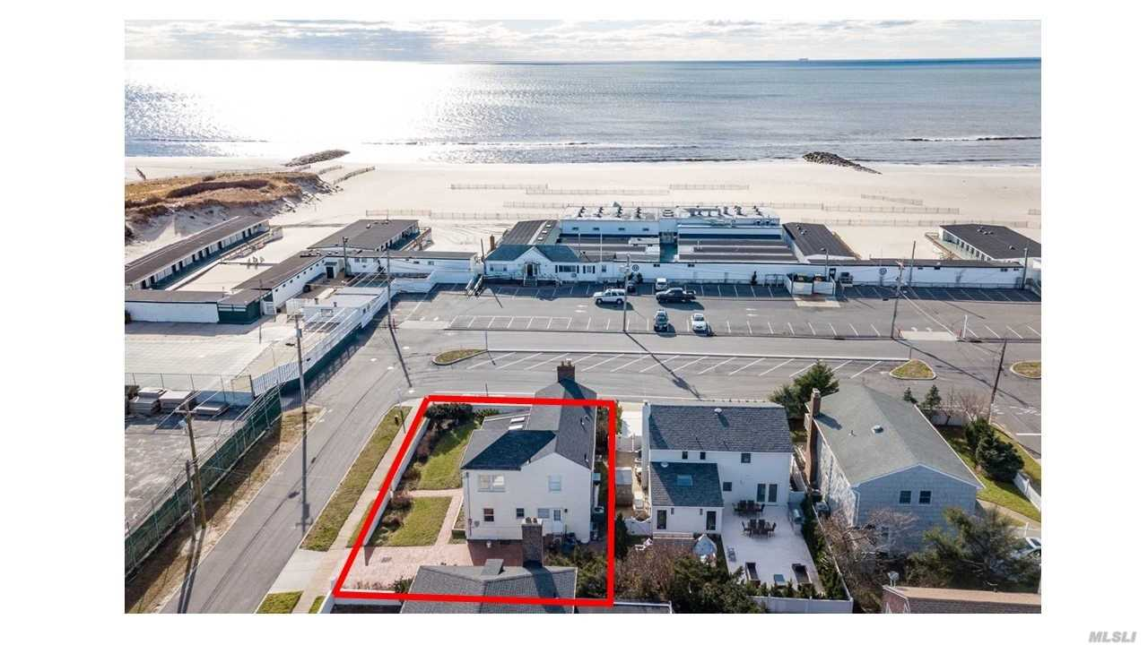 Your Summer Getaway is here Ocean views in the Village of Atlantic Beach 4 Bed 3 Bath Eat-In-Kitchen Gracious Colonial Close to all Large Master Suite Open Floor plan . Great for summer entertaining inside & Out