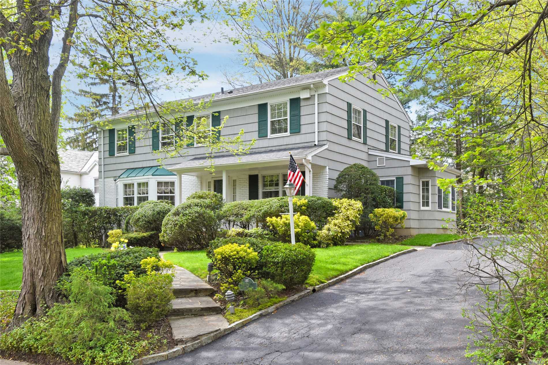 Welcome To This Sunny, South Facing Colonial In The Desirable Village of Russell Gardens W/ Private Community Pool/Tennis. Situated On A Beautiful Tree Lined St, Mins To Town, LIRR And Bus. Lg Entry Leads To LR W/Fpl, Huge Den With Cathedral Ceiling And Radiant Heated Floors Overlooking Private Yard. Renov EIK, DR, 1/2 Bth, Laundry On Main Level And 2 Car Garage. 2nd Floor Master Bdrm W/Full Bth And Walk-In Closets, 3 Add Bdrms W/Full Bth. Great Neck South Schools And Park District Amenities.