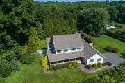 This home has everything on your wish list! Beautiful Strong's Neck location, sprawling .71 acre level property with in ground pool. Sun filled home with generously proportioned rooms and excellent layout, New kitchen, renovated bathrooms, gleaming oak floors throughout, 3 fireplaces (and yes one is in the master bedroom!) Updated systems, young roof, windows, doors, CAC, IGS. But the best thing about this home is the feeling you get when you are inside it! Relax, you're home at last!