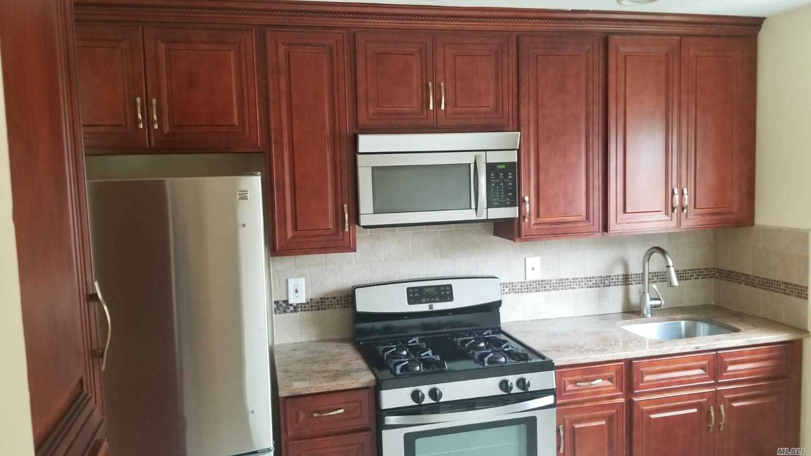 Large Renovated, New Kitchen-Cherry W/Granite Counter, Stainless Appliances, hardwood floors, Large Bedrooms, 2nd Fl. Wallk To Lirr, Close To All. Heating Included