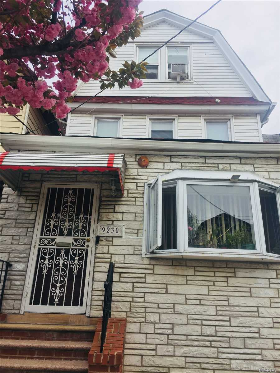 Large house in quiet street located minutes from subway stations. 5 bedrooms and a stunning open floor plan on first floor makes this a must see. 2 parking spaces and a big backyard to enjoy. Endless possibilities and able to convert into a two family home!