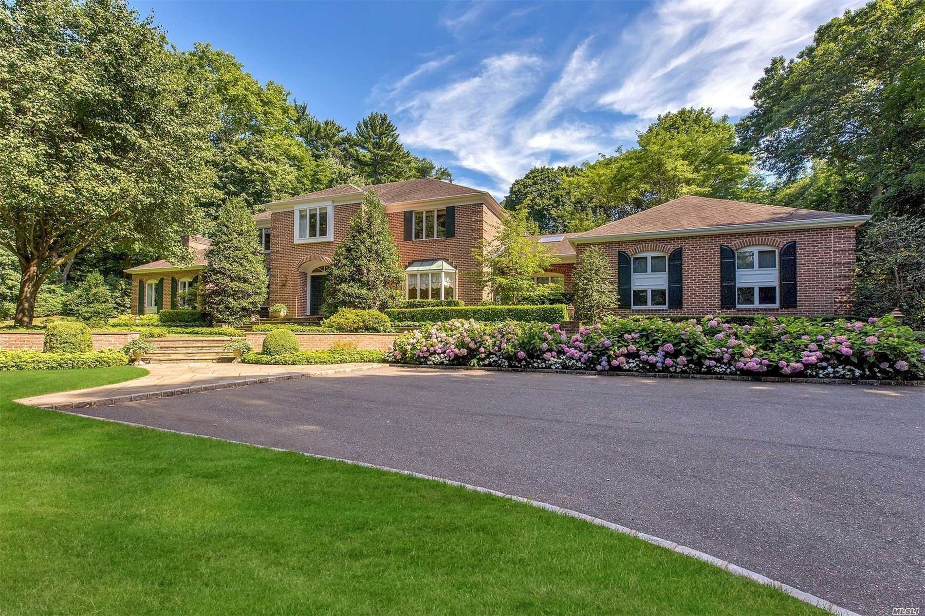 Extraordinary Value! Quietly Set Back This Majestic 7 Bdrm Brick Colonial Displays Luxuriously Proportioned Rooms & Majestic 2 Story Foyer. Master Suite Offers Spacious Office. Sep Guest Wing W/ 3 Bdrms & 2 Baths Perfect For Extended Family. Magnificent Pool & Trellised Cabana Features Add'l Kitchen & Bath. Set On 2+ Acres Of Spectacular Landscaped Grounds. Special Features Incld Media Rm & Wine Cellar, 3 Car Garage, Generator & Driveway W/Heating Coils. Jericho Schools. Listening To All Offers.