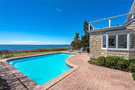 Dreamy 1930's cape on Peconic Bay with stunning views from Jessup's Neck to Nassau Point. The water side pool, privacy, charm, 4 bedrooms, 2 full baths, detached garage, full basement and all updated mechanicals makes this property the complete package for any serious bay front buyer. Fully bulk headed low bluff stairs lead to 100 feet of private sandy beach and shared dock in community docking area. Bay front beauty.
