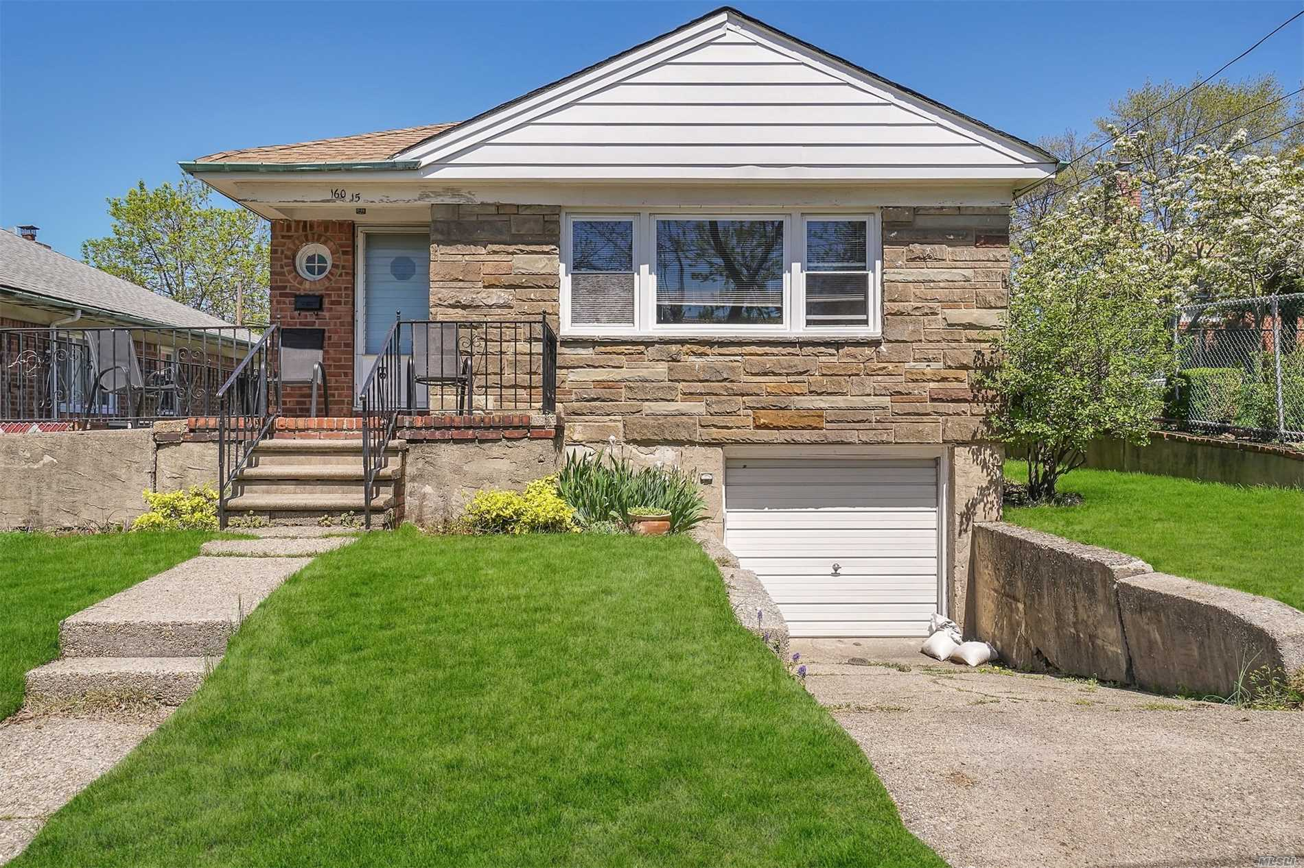 This Whitestone Detached Brick Raised Ranch House Offers Large Bedrooms and Living Areas, Hardwood Floors Throughout, a Basement with High Ceiling and a Private Driveway and Garage. Close to All.