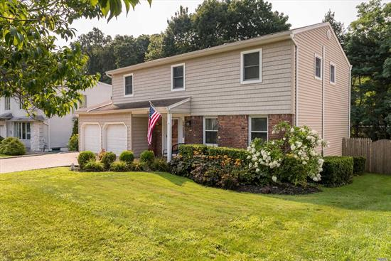 Large Bright and Airy Colonial, Home Features Grand Entry, Eik W/Granite Counter Top, Living Room, Dining Room, Recreation Room w/Panoramic Sliding Door to Rear. The 2nd Flr. Features 4 King Size Bedrooms & 2 Full Baths, Substantial Master Suite w/walk in closet, sitting area. Exterior Enhancements Include Immense Entertaining backyard w/Substantial Deck, In-Ground-Solar/Heated-Pool, Stone Patios, In-Ground-Sprinklers, Manicured Property w/2 car extra large garage w/storage room.