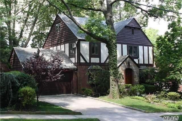 LOCATION, LOCATION, LOCATION! One Of A Kind Tudor Style House Sitting On An Extra Large Lot On The Widest Block In The Most Secluded Section Of Jamaica Estates. This Home Features 5 Bedrooms, 3.5 Bathrooms, 2 Car Garage And Backyard Great For Entertaining.