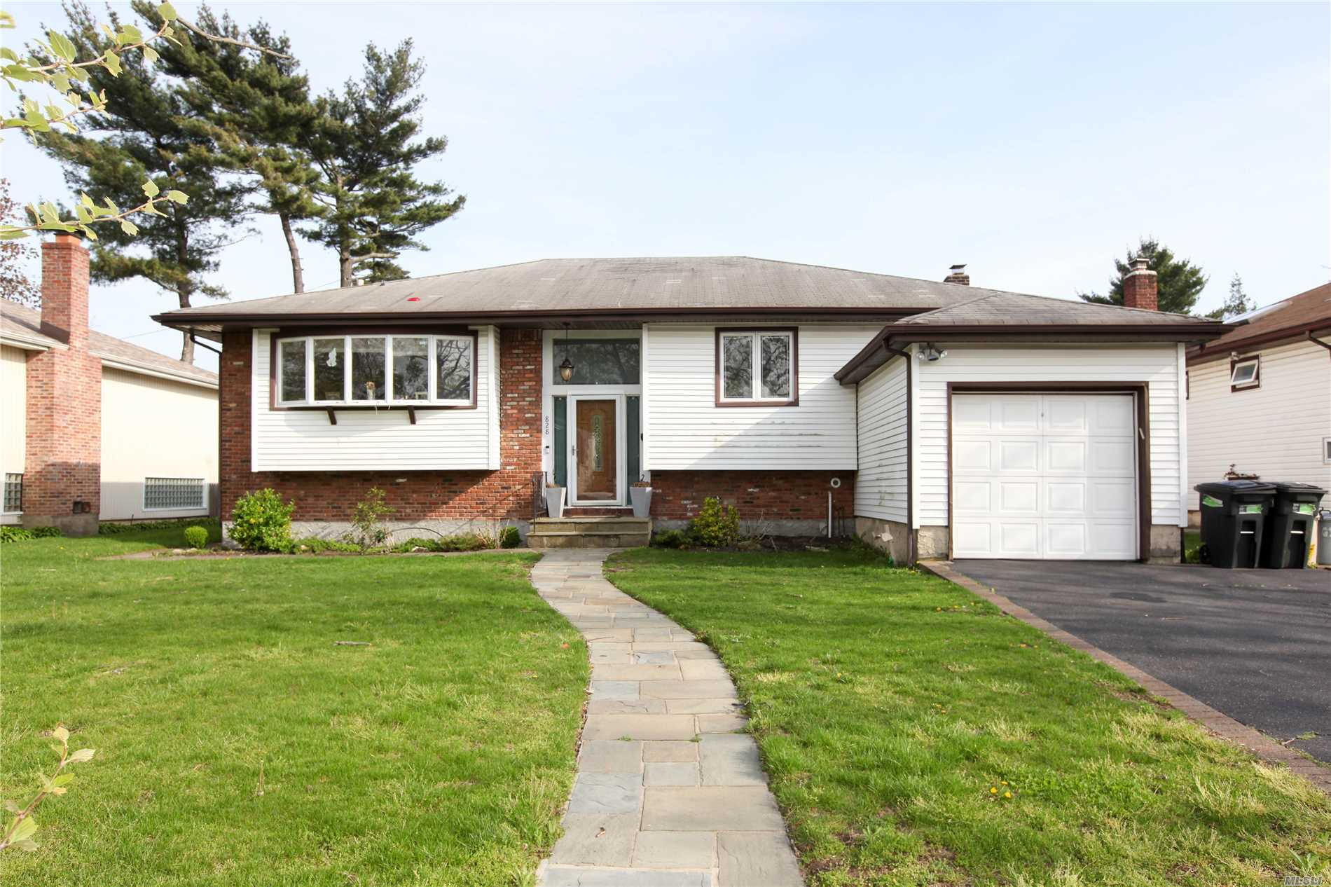 Beautiful Modern Hi Ranch, 6 Bedrooms, 3 Full Baths, Newly Renovated Eat In Kitchen, Large Formal Dining Room, Living Room, Huge Den, Playroom, Must See!
