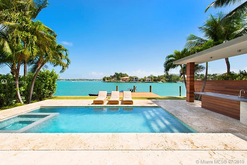 On Venetian Islands, Sits This Exquisitely Designed Architectural, Custom Home. A Model Of Sophistication, It Showcases Unprecedented European Craftsmanship And Bespoke Details Which Elevate The Property To A True Work Of Art. This Tropical Modern Home Offers An Open Floor Plan With Floor To Ceiling Sliding Doors That Seamlessly Integrate The Indoor And Outdoor Spaces For The Ultimate Florida Lifestyle. The Main Level Consists Of Living And Dining Rooms, Kitchen With Miele Appliances, Family Room, And An En-Suite Bedroom Or Office.The Upper Level Holds Four Ensuite Bedrooms Including An Opulent Master Suite With Large Closet, Luxurious Master Bathroom, And Designer Fixtures And Finishes. The Outdoor Area Contains A Large Pool With A Covered Bbq And Outdoor Shower.
