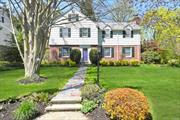 Classic Manhasset Bay Estates Center Hall Colonial is the one you've been waiting for! The home's floor plan is tailor-made for an easy lifestyle: comfortable, oversized living room with fireplace, lovely formal dining room opening to the updated cook's kitchen with large, windowed eating area and adjoining family room. The first floor also includes laundry and a powder room. 4 Bedrooms and 2 full baths on the second floor include a large master with great closets and stunning bath.