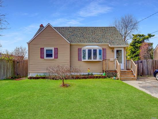 Expanded Cape -This 3/4 Bedroom 2 Bath Cape has an eat in kitchen, living room, unfinished basement and a Large Fenced in Backyard - Updates include Windows, Siding, Kitchen And Baths, Vulcan French Drain System w/lifetime guarantee in Basement and New Oil Tank -