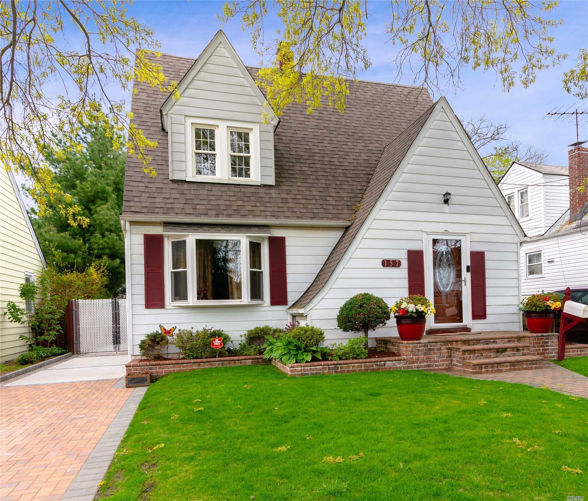 This Beautiful Tudor/Colonial nestled near to the Ingraham Estates area is in the Uniondale School District, and has many other desirable features. The LR has a wood burning FPL, & flows into the FDR which lead to the kitchen, & then out to the fabulous deck & backyard. H/W flooring throughout , 2 zone heating, 220 Amps electric, 7yrs young roof, Gas Heat & a finished basement are just some of the additional amenities that you will find in this perfect starter home or downsizing perfection.
