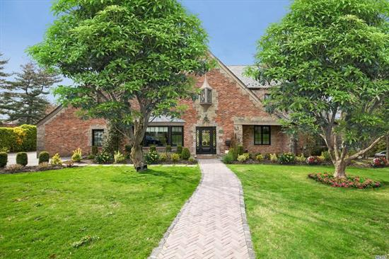 Beautiful Renovated Brick & Stone Colonial in Strathmore Village. This Spectacular Home Features 5 Bedroom, 5.5 Bath. Formal Living Room w/Fplc; Elegant Dining Rm; Chef's Eat-in-Kitchen; all Upscale Appliances, Marble/Travertine Counter Tops and Family Rm Combo w/Gas Fireplace. 14 Zone Radiant Heated Flrs throughout; Master Suite w/Luxurious Bath and Balcony. Fin Basement w/Media Room w/Sub-Zero Ref, 1/2 Bath and Gym. 2 Car Garage/Paver Stone. Driveway. Munsey Park Elementary. Taxes Grieved.
