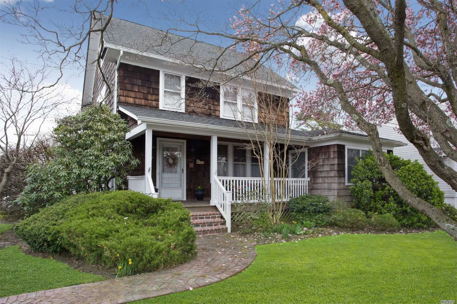 A beautifully maint 3br/2bth Colonial w/2 car gar, fully fenced yd w/mature landscaping, IGS, close to all. Spec features inc wood flrs thru out, Lrg Fml LR w/wood burning Fireplace, Den w/2 skylights, & a cozy window seat. Updated Kit & eating area w/Tin tiled ceiling & bksplash, Silestone Island & Countertops, Birch & Glass Cab leading to a DR w/sliders to an updated Wood Deck overlooking a small Koi pond. Updates inc New Roof, HW Htr & Oil Tank, 200amp elec, Alarm sys, & AC. Move in ready.