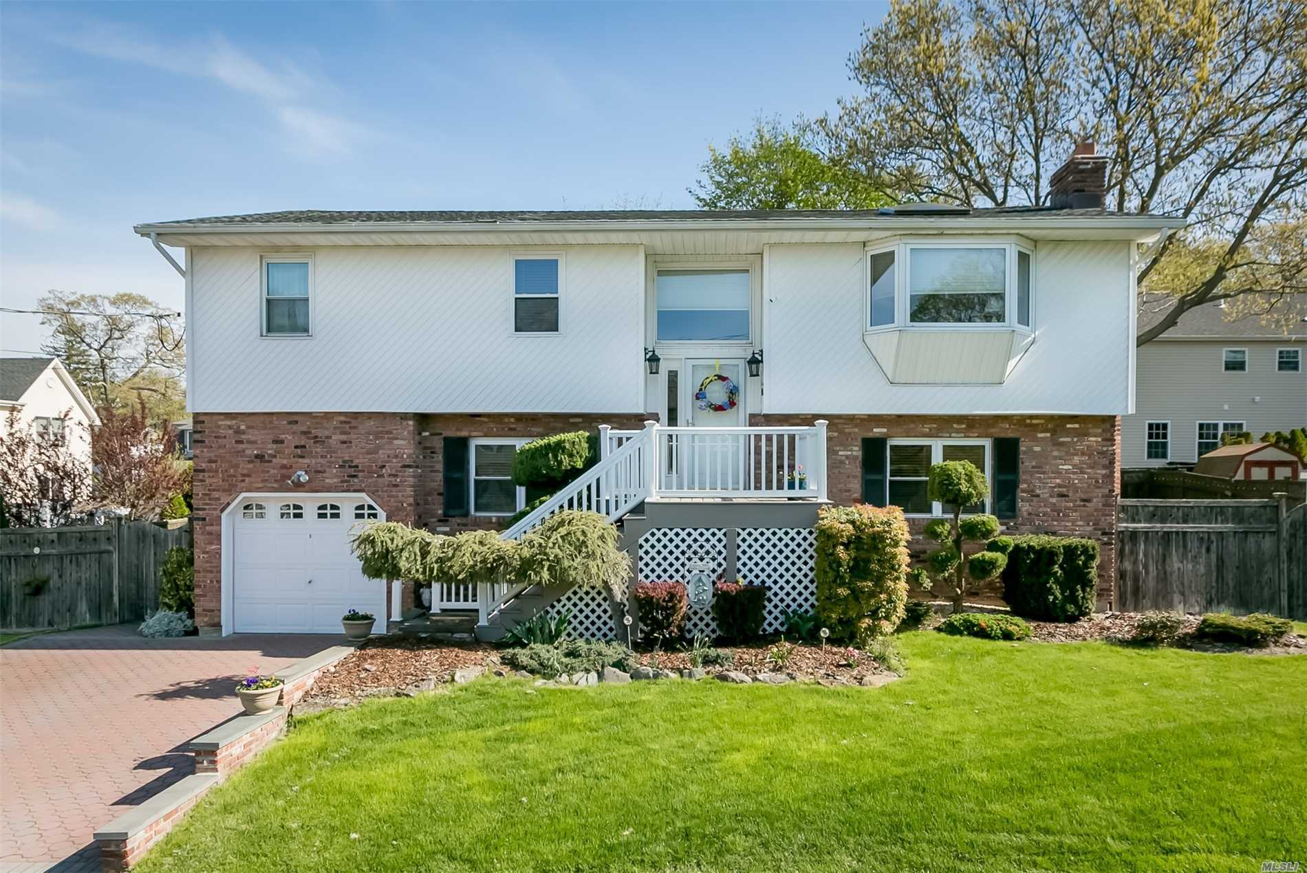 Immaculately Maintained Over-sized High Ranch with Full Basement (exit to yard) Located on a private cul-de-sac in Renowned Bethpage School District 21. Many Updates including Kitchen, Windows, & Roof. Also includes Ductless Heat/Air System Downstairs, CAC Upstairs, 2 Composite (TREX) Decks - one with Built in Seating. Tons of Closets & Storage Throughout. Close to LIRR, Library, Town, Park & Championship Golf Course. New Price.  Don't pass this one up !