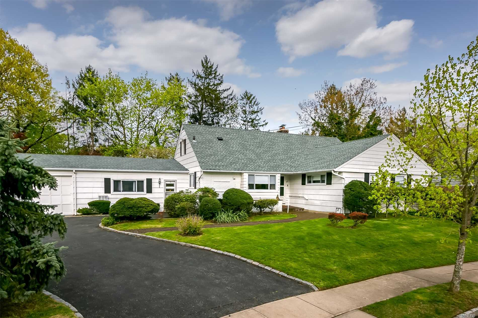 Beautifully Kept Expanded Cape W/ Over 2600 Sq Ft Of Sprawling Living Space Not Including The Bonus Unfinished Walkup Attic. Located In The Todd Estates Of The Award Winning North Shore School District On A Over Sized Private Park Like Yard Perfect For Entertaining. Three Large Bedrooms Including A MBR En-Suite, Formal Dining Room, Office, And An Expansive Den Ideal For Entertaining. Low Taxes, Two Car Garage Close To LIRR, Shopping, Restaurants And Much More.