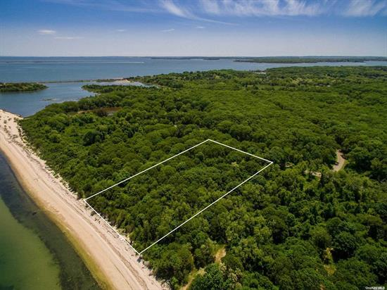 Great Opportunity! 2.62 Acres, With A Low Bluff Directly On Long Island Sound In East Marion. Part Of 40-Acre Previously Owned By Billy Joel. Now An Exclusive Private Community With Ten Individual Plots. The Beach Is part of this Property - protected by elevation just Enough For Panoramic Sound Views And Unparalleled Sunsets! Gated Property.