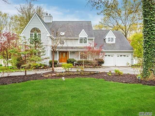 This large post modern colonial features an open floor plan with vaulted ceilings and large, light filled rooms. Amenities include a floor to ceiling gas fireplace with a Louis XV mantel that soars to the second floor, hardwood and ceramic tile floors throughout the house, recessed lighting, ceiling fans in each bedroom, a finished basement with a media room, a large muti-level evergrain deck and L shaped inground pool. Fabulous home in Kings Park School District.