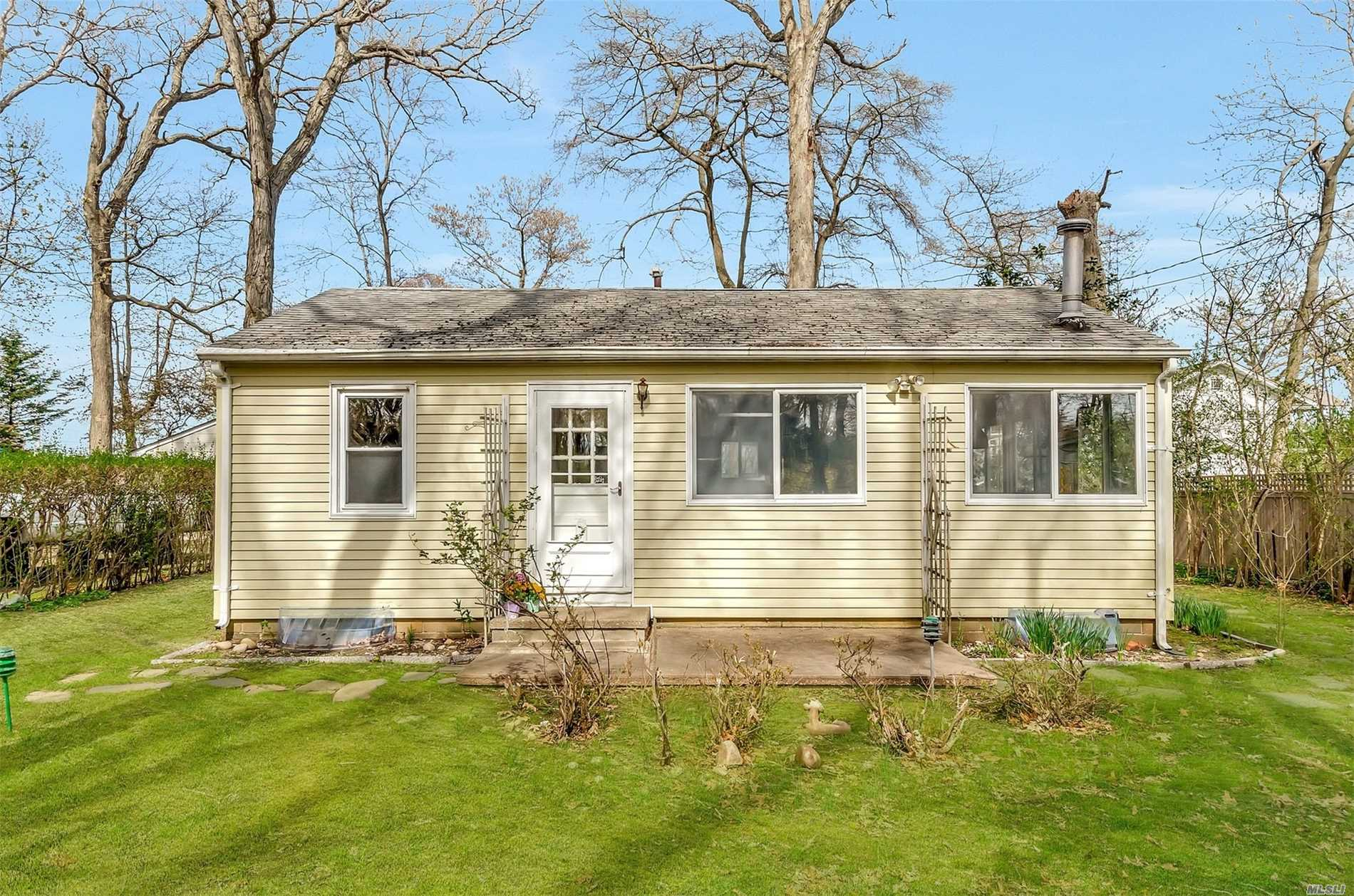 Greenport Beach Cottage - 2 bedroom, 1 bath starter home or investment property just steps to Bay beach overlooking Shelter Island. 1.5- car garage on private road...will not last!