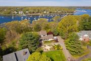 Updated, modern & private Craftsman with wide open Huntington Harbor winter water views. The interior features 4 bedrooms, 3.5 baths, an open kitchen, formal dining room, living room with cathedral ceilings, fireplace and an attached 2-car garage. The lower level includes an In-law or nanny suite with summer kitchen, living room, bedroom, full bath, a large gym or storage area and access to the rear yard. Set on .53 acres of land, the entire rear of the house has an IPE Wood deck.Possible 5/6 BR