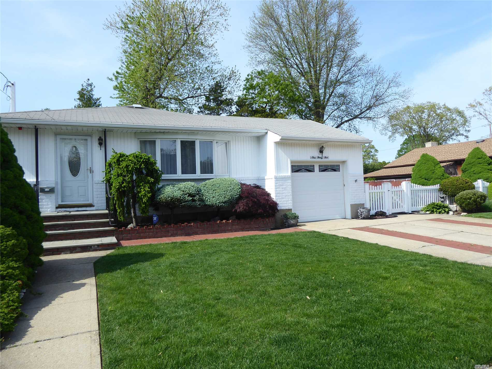 Immaculate 3 Bedroom 1.5 Bath Ranch With Hardwood Floors On Fully Fenced And Perfectly Manicured (Landscaping Included) 86X100 Lot. New Kitchen Has White Shaker Cabinets, Stainless Appliances And Quartz Counters. Plus Garage, Double Wide Driveway And Basement With Wash/Dry On Quiet Street. Farmingdale Sd#22.