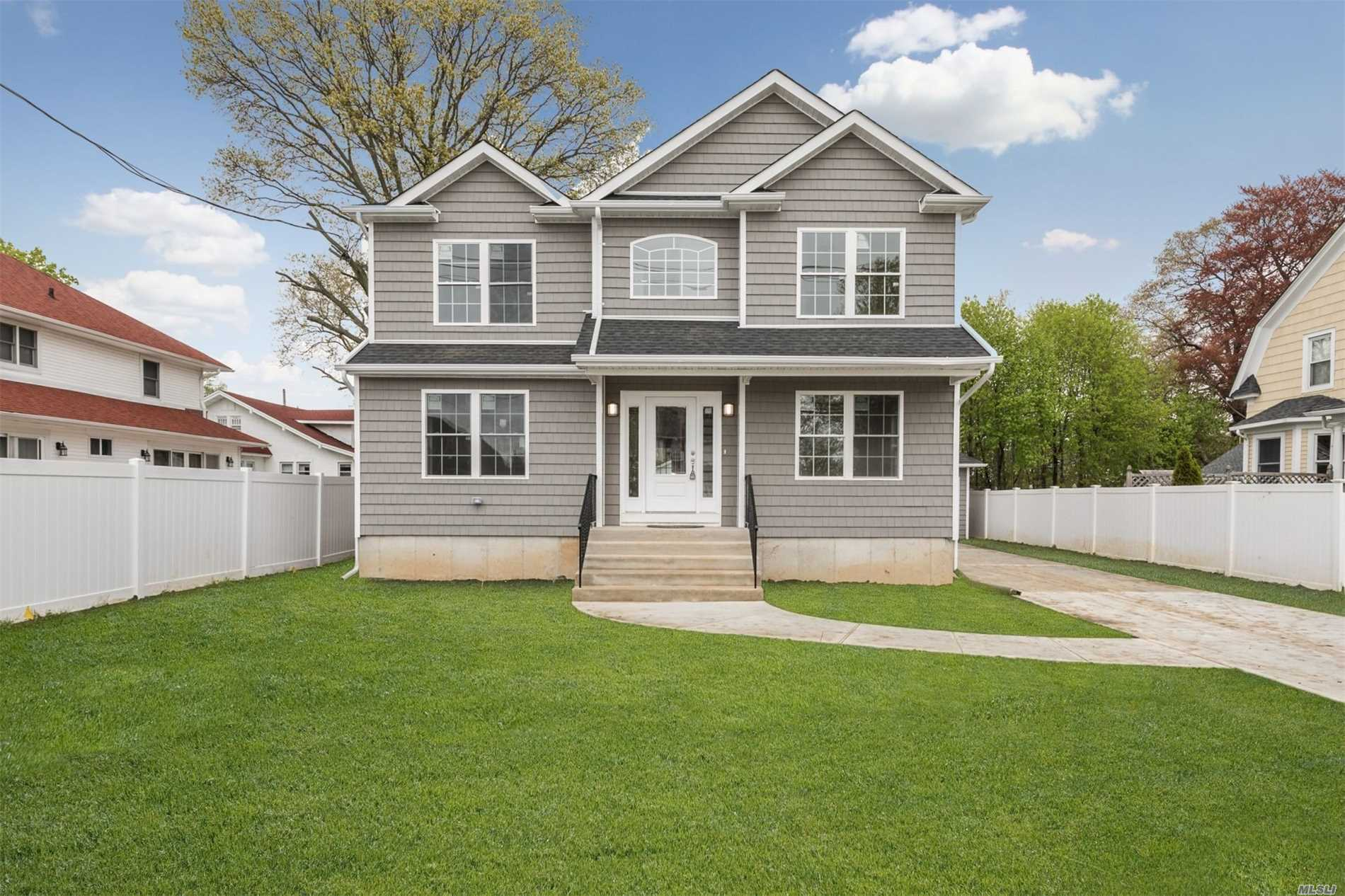 Location, Location, New Home in the Heart of Baldwin. Granite and Stainless Kitchen, Master Suite with Full Bath and walk In Closet. 4 Add'l Bedrooms. Full Basement with Outside Entrance. Close to Train and Transportation.