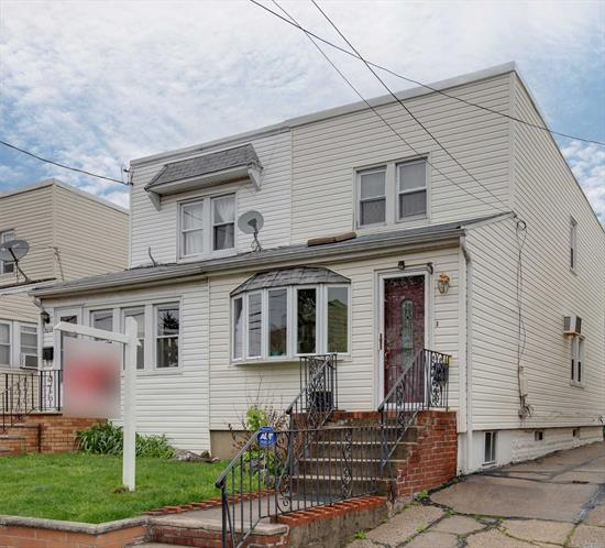 Updated Semi-Detached Colonial in Prime Bayside Location! 1st Floor Offers LR with Raised Ceiling and Skylight, FDR, Granite Kitchen with S/S Appliances, 1/2 Bath, Rear Den with Sliders to Deck. 3 Bedrooms 1 Bath Upstairs, Finished Heated Basement with Family Room, Storage Room plus Boiler and Laundry Combo,  Newer Windows, Updated Gas Heat,  Just Move in!. Near Schools, Shops, and Transportation.