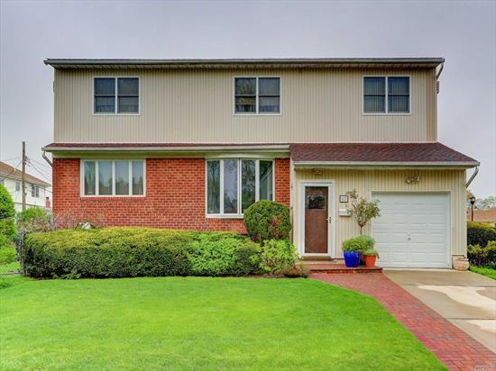Beautiful home located in a cul de sac off of Dahlia. Oversized home with great living space. First floor boasts EIK open layout into dining room. Nice size living room too. Huge Den or extra bedroom on first floor with an additional bedroom and a full bath. Second floor has 5 extra large bedrooms including a master suite with full bath. This not a flood zone. Basement has 8 feet high ceilings with an additional half bath. Pride of homeownership! Near highways, transportation and shops.