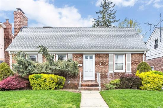Beautiful Brick Wide Line Cape In Franklin Square SD. Offering Spacious Eat-In-Kitchen w/Sliders to Deck, Living Room w/Fireplace, Hardwood Floors, Lg Bedrooms, Lots of Closet Space, Huge Upstairs Loft, CAC, Fabulous Renovated Basement with Family Rm/Custom Granite Bar, Det Garage, Security Alarm, Private yard w/Patio for Entertaining. Upgrades Include: New Gas HW Boiler, Sep HW Heater (2016), Roof (2014), New Driveway, Updated Full Bath. Great Location...Close To All. Low Taxes! Move Right In!