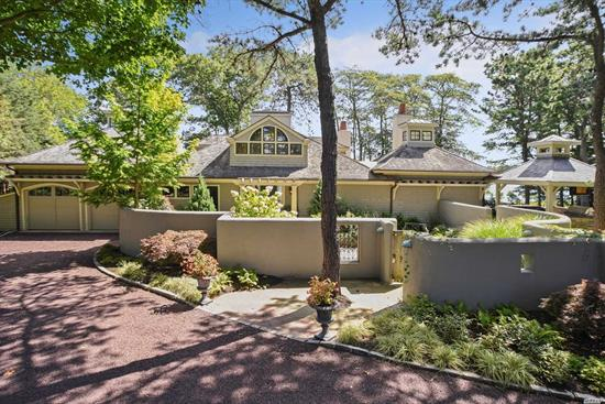 Unique opportunity to live on a private lane close to the village and beaches of WHB. Bayfront Hamptons Villa. Bring the water toys and enjoy waterfront living at its best. Park them at your private floating dock. Enjoy a coffee or cocktail in the pool, hot tub, or covered outdoor bar/kitchen, surrounded by a mahogany deck. One story, open concept floor plan with soaring ceilings/windows, LR/DR, chef's kitchen with views of the bay from every angle. 3 ensuite BR's.2 lofts and so much more.