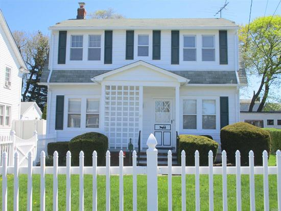 Beautiful well maintained 5 Bedroom, 2 Bath Colonial with Formal Dining Room, spacious Living Room, Den, Walk Up Attic and 3 Car Garage. (one used for storage) Mid Block Location.