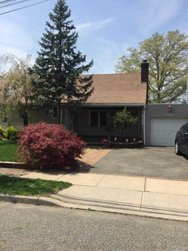 Beautiful, spacious, 4 bedroom, 3 bath, expanded ranch. EIK, FDR, LR with fireplace, Den with wood burning stove, laundry room, hardwood floors, sliders to deck. Waterview, great size yard, near LIRR, Easy to show.