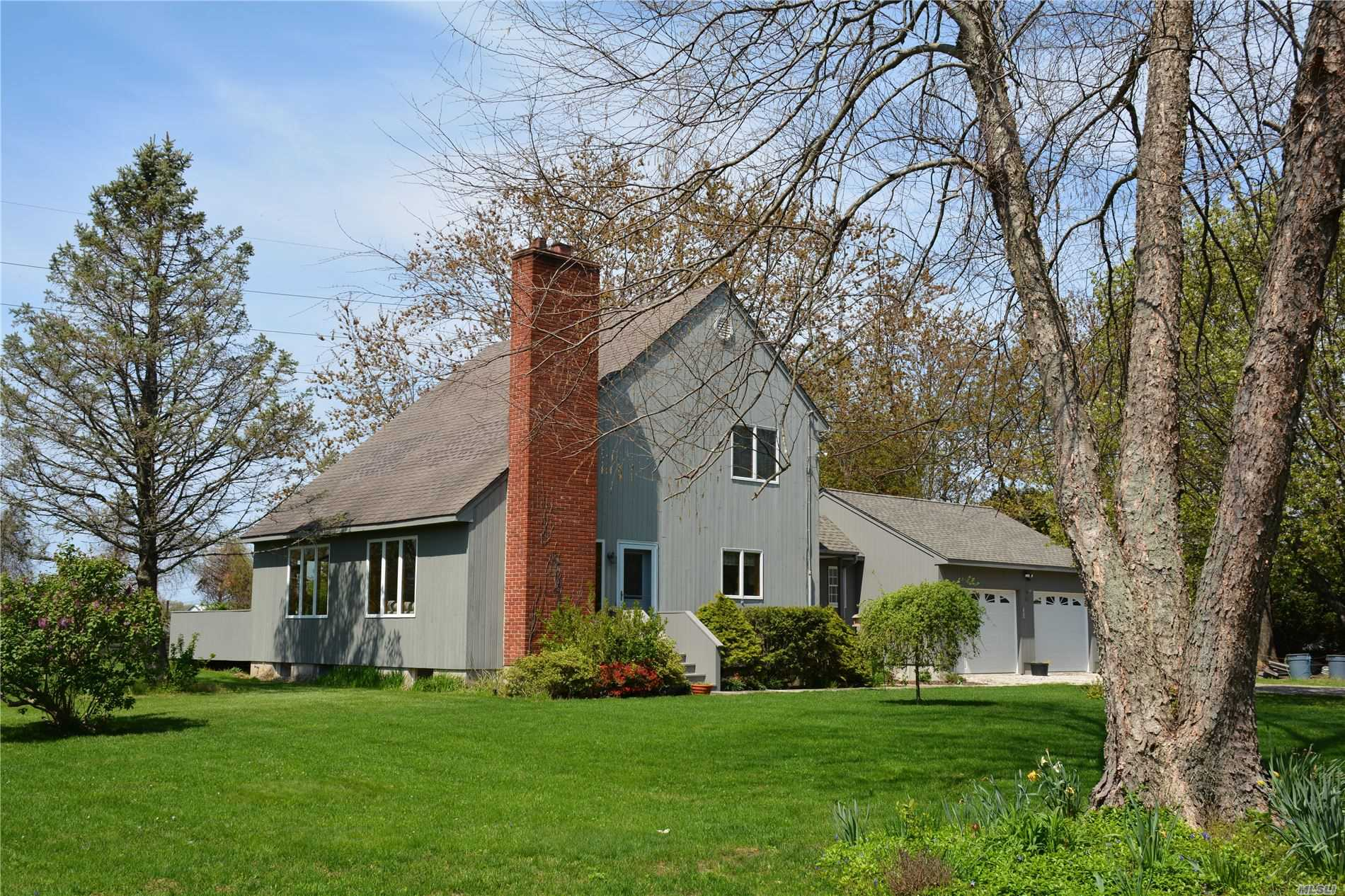 Wine Country Secluded Saltbox on 1.7 acres of private green lawns and pasture surrounded by preserved farmland. Enjoy this open floor plan with great room, fireplace, and fantastic 3 season sunroom.Three Bedrooms & 1.5 baths. Room for horses, goats, chickens, or pool and tennis court. Hardwood floors, attached 2 car garage and privacy abound here on this flaglot setting on the beautiful North Fork.