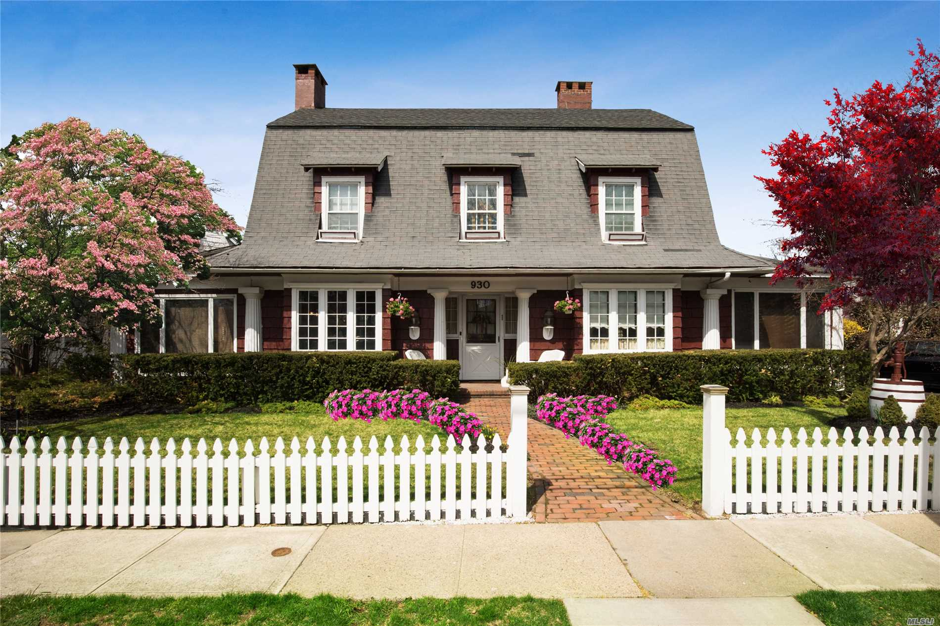 Old Woodmere Center Hall Colonial with exceptional detailed quality woodwork! Elegant 5 bedrooms, 3.5 bath, 4 fireplaces, extra -large eat in kitchen w/Mexican tile floors, Indoor commercial grill and granite countertops. Large formal dining room and formal living room , 2 dens, master suite with updated ensuite and fireplace. Newsday's Cover of Holiday Issue. Walk to all!