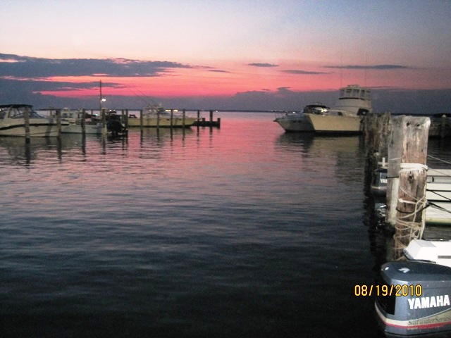 Beautiful sunsets and sunrises, 2 bedroom/2 bathroom duplex with unobstructed bay views from living room and dining area, as well as bedroom and upper and lower decks. Boat slip available.  Low Common Charges ($312/month) which include flood insurance!