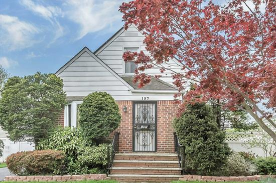 brick 4 bedroom, cape, hardwood floors, full basement, garage, formal dining room, great storage and more.  Leased solar panels.  Central air conditioning,  Stainless steel appliances, stove, refrigerator and dishwasher. High hats,  New windows, gas cooking and gas hot water heater, security cameras & monitor, garage and newly paved driveway, laundry room, brick house