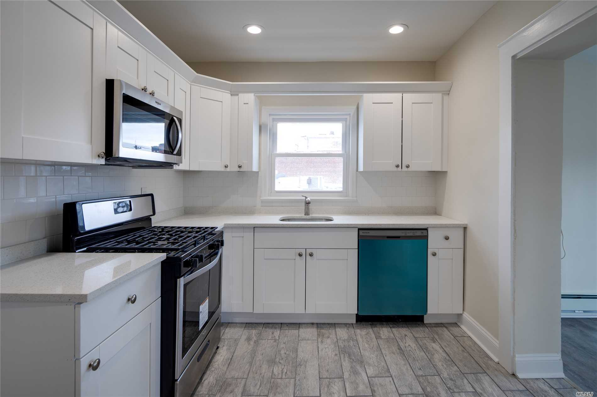 Beautiful Clean and All Brand New!Sd#14. Large Kitchen new SS Appliances + Quartz Countertop. Large Living Room. Large Dining Room 2 Bedrooms. Huge Bonus Own Washer And Dryer In Apartment. All New Windows, Plumbing, + Electric. Large Parking Lot In Rear. Walk to all - Amazing opportunity to Rent in SD#14 Immediate availability. No Pets and No smoking