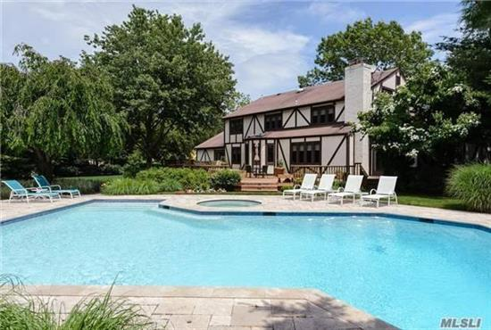 Secluded Estate On 2 Acres Of Park Like Grounds In Private Community. This Tudor Luxury Home Boasts A Resort Style Gunite Pool, Tennis Ct. High Vaulted Ceilings. Brand New Hardwood Floor and New Organic Paint Throughout. High-End Appliances, 5 Br, 4 Full Bath, 3 Half Bath. Syosset School- Berry Hill Elementary, SouthWoods Middle School!