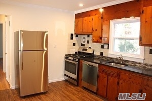 Renovated First Floor Apartment With Private Entrance! 2 Bedrooms, 1 Bath, In The Heart Of The Village! New Bath, Windows. Stone Kitchen Countertops, Stainless Steel Appliances, All Hardwood Floors, In Wall Air Conditioning, Washer And Dryer. Gas Heat And Cooking! Spacious Basement Included. Private Off Street Parking