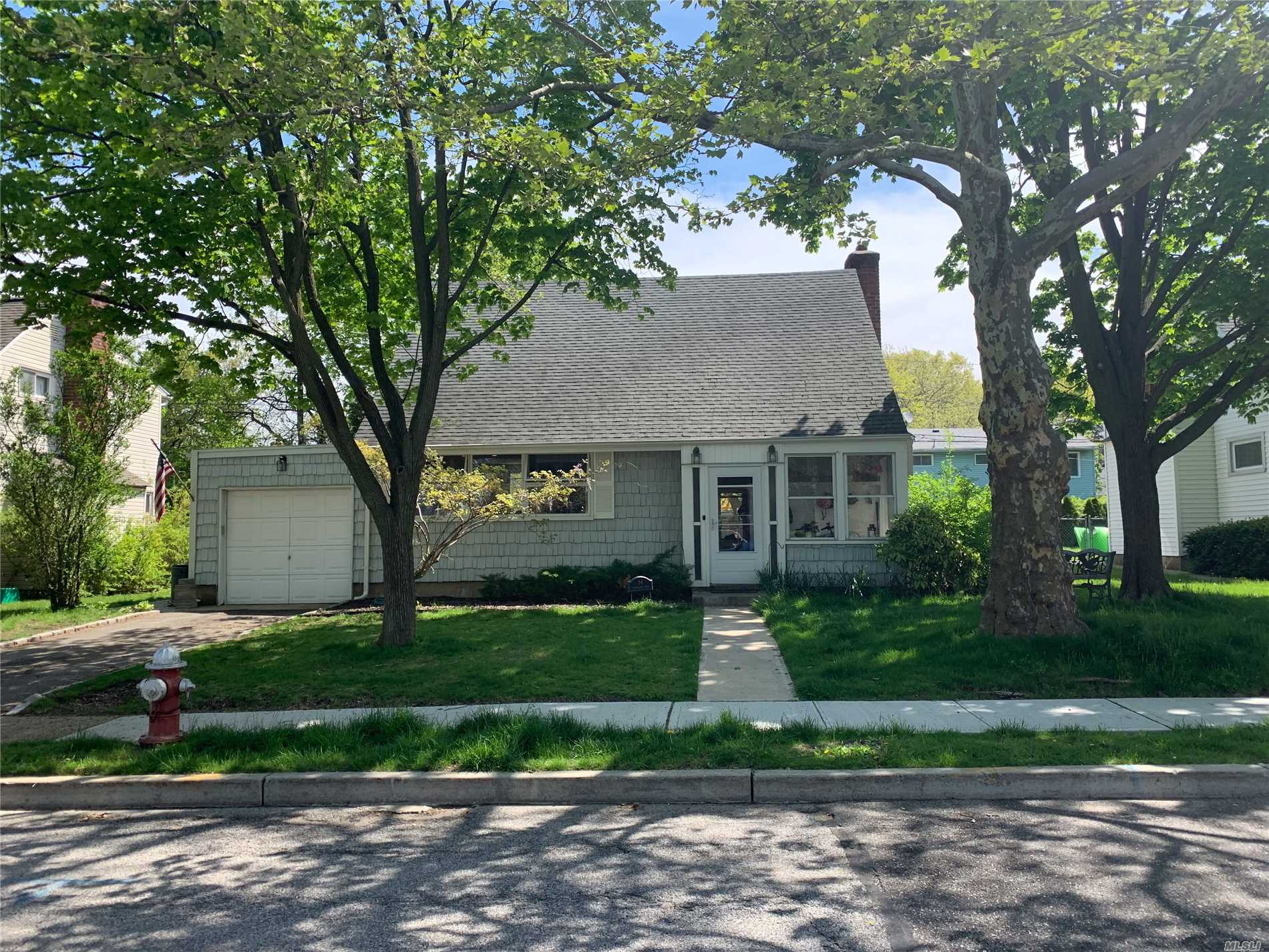 This 3 BR, 2 full bath cape situated on 60 x 100 has an updated kitchen with large island, first floor full bath with radiant heat. This as Is house is a great opportunity for first time buyer or scale down. Gas heat, private driveway, near to parks and school. Garden City Schools.