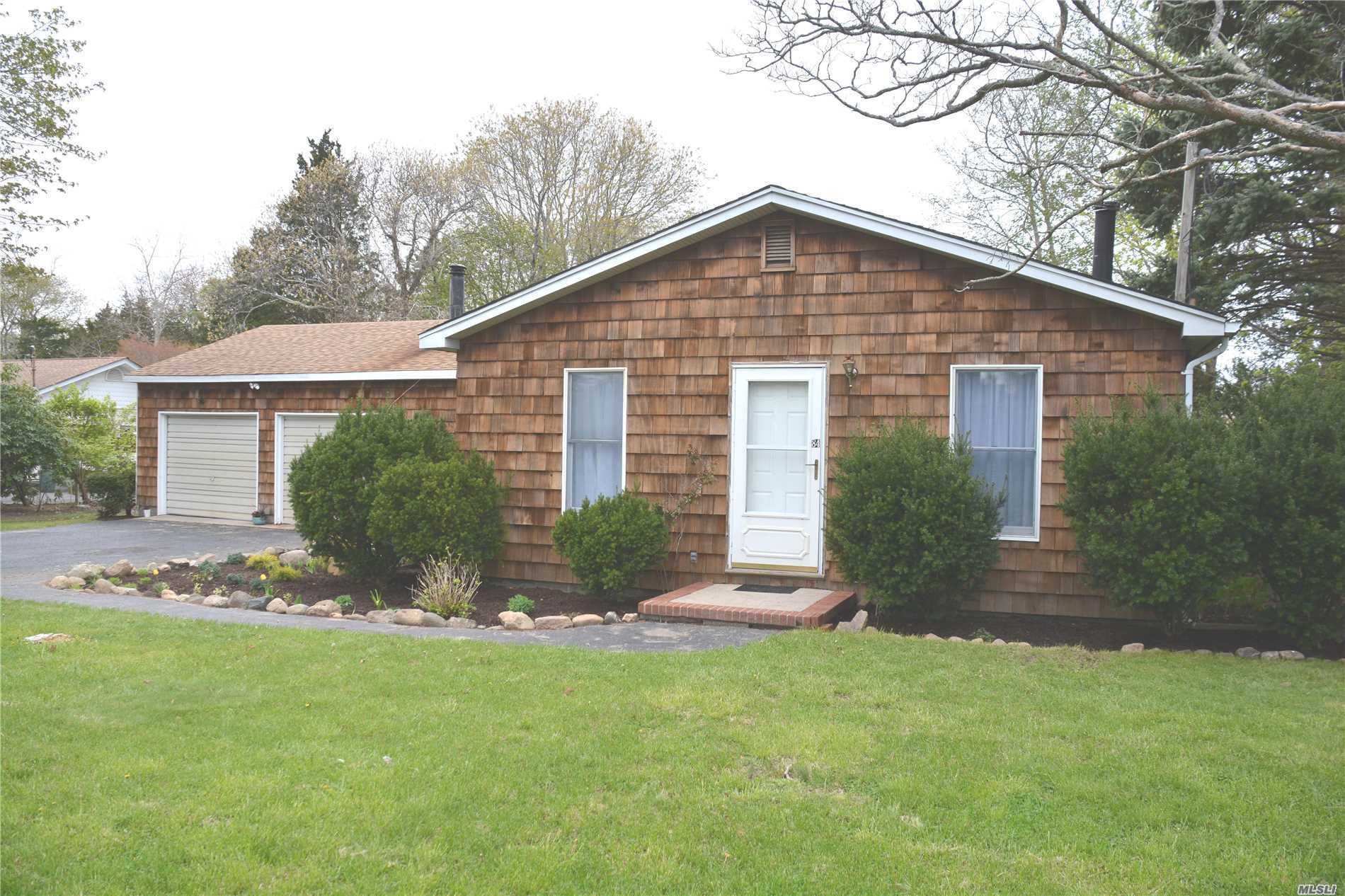 Cedar Shingled Ranch with Seaside South Jamesport Setting. Large backyard with room for pool. Spacious Living Room. Put your own style and ideas onto this blank canvas. Great Location! Close to the marina, numerous sandy beaches and playground. Wine country and fabulous North Fork restaurants.