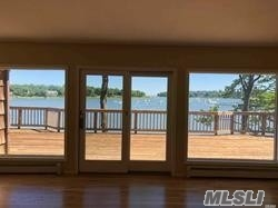 1975 Young Home Featuring 5 Bedrooms, 3 Baths, 2 Car Garage with 232' Private Beach and Breathtaking Panoramic Water Views . Open Floor Plan With Full Wall Windows And Sliders To Huge Deck Overlooking Setauket Harbor, Cathedral Ceiling, New Cac, Full Finished Walkout Basement with wall of windows facing the water. Its Last House On Private Street, Low P.Tax, Desirable Three Village School District. Many Potentials To Make It A Multi Million Masterpiece.